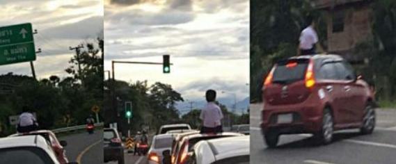 На севере Таиланда оштрафовали отца, который покатал сына на крыше машины
