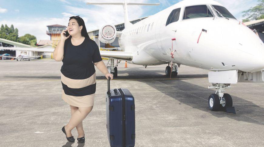 Ученые нашли связь между частыми путешествиями и ожирением