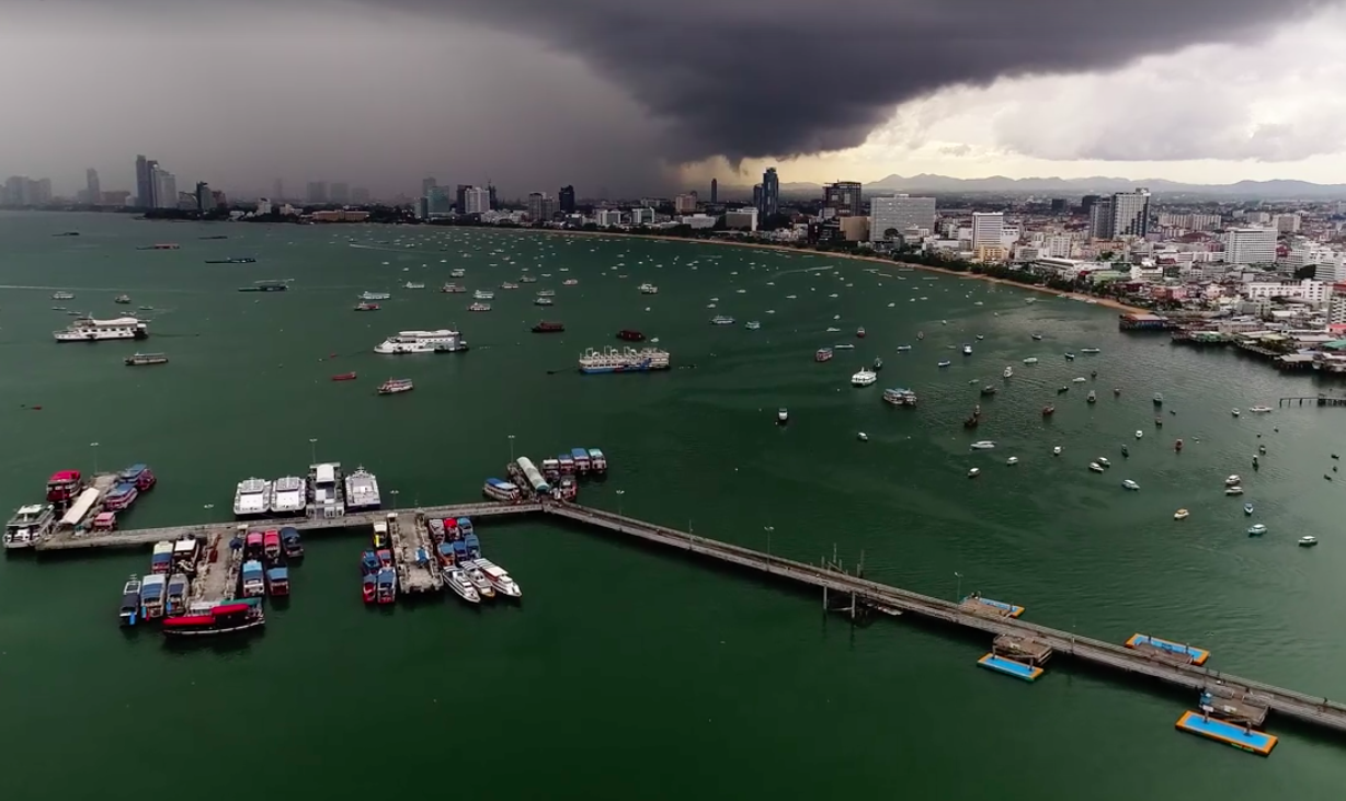 Hyperlapse of a big storm brewing across Pattaya bay from the Pattaya sign.